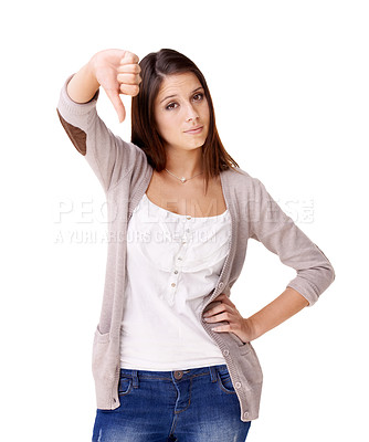 Buy stock photo Smiling young woman giving a thumb's down against a white background