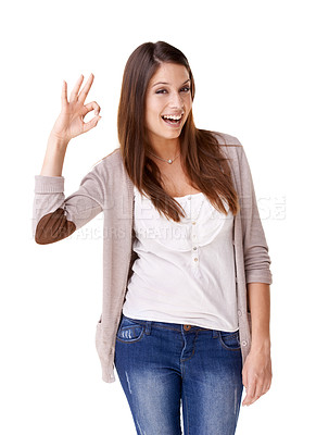 Buy stock photo Casually dressed young woman giving the OK sign against a white background