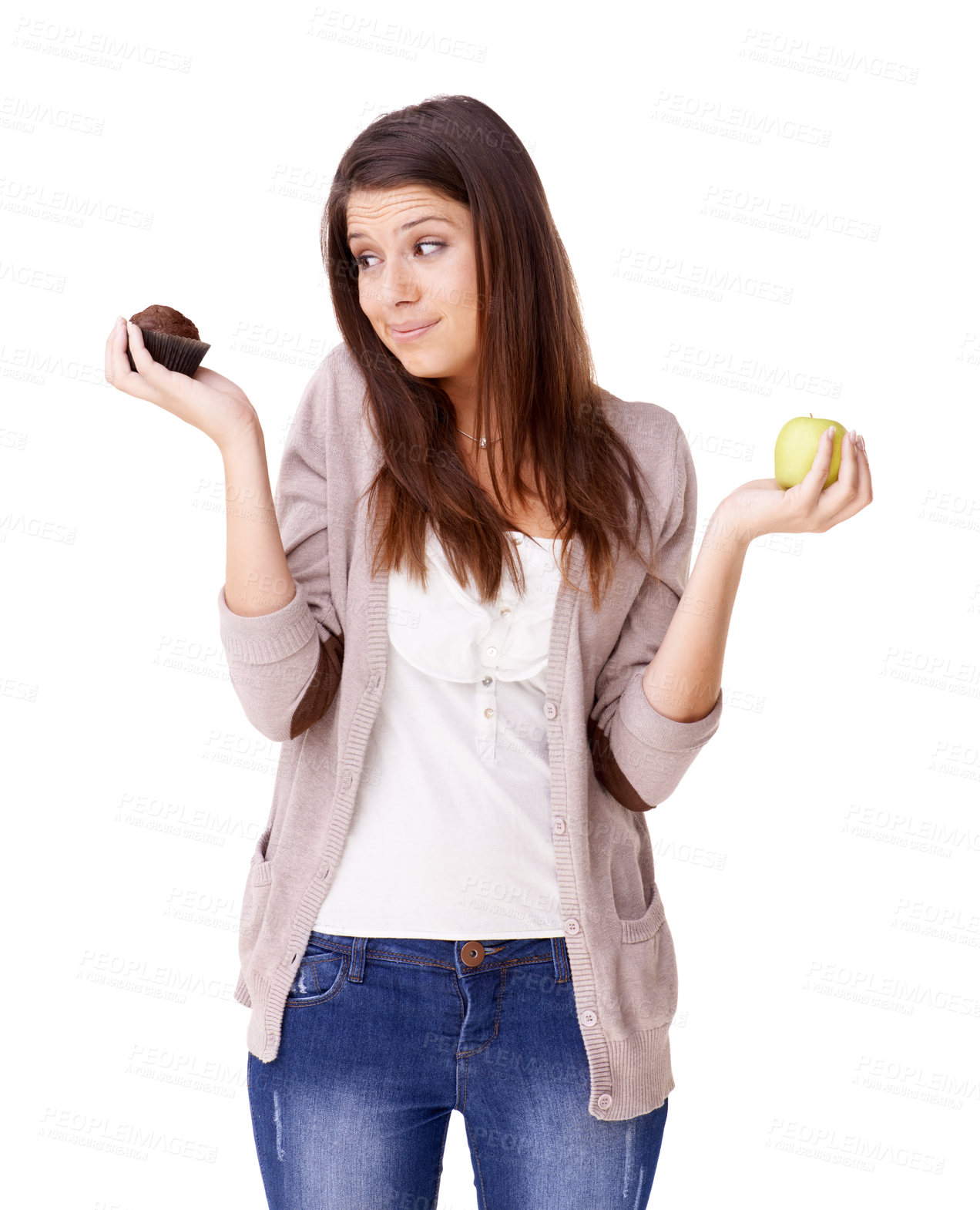 Buy stock photo An attractive young woman choosing between an apple and a muffin