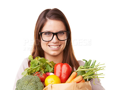 Buy stock photo Portrait of a happy young woman holding a bunch of vegetables