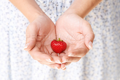 Buy stock photo Cropped image a woman's hands holding a strawberry