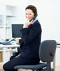 Happy business woman speaking on the phone