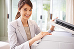Happy business woman working on the photo copy machine