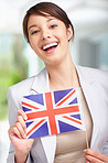 Cute young woman with United Kingdom´s flag