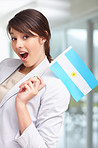 Cute young female with an argentinian flag