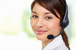Closeup of a happy sweet young woman wearing a headset