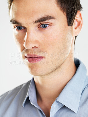 Buy stock photo Closeup portrait of a young man looking away in thought on white background