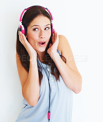 Buy stock photo A young woman singing along to a song