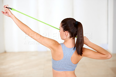 Buy stock photo A beautiful young woman doing resistance training in the gym