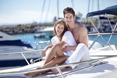 Buy stock photo Young couple having fun on a yacht together