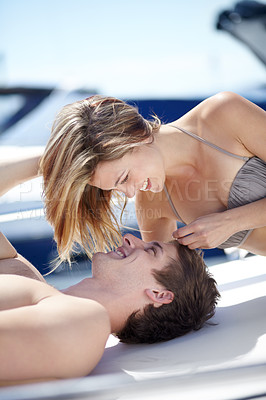 Buy stock photo Pretty young woman romancing her boyfriend on a yacht