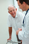 Elderly man speaking to a doctor , health issues