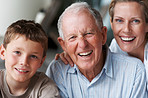 Old man laughing with daughter and grandson