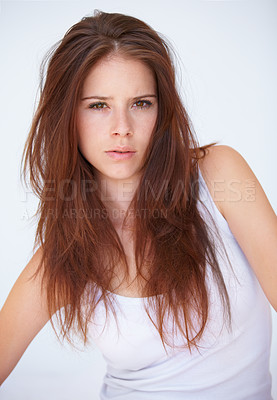Buy stock photo A young woman with messy hair looking groggy