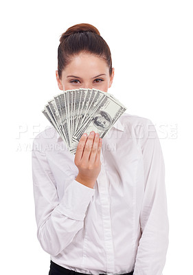 Buy stock photo Studio portrait of a young woman holding fanned-out dollar bills in front of her face isolated on white