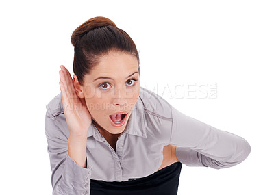 Buy stock photo Studio portrait of a surprised-looking young business woman cupping her hand to her ear isolated on white