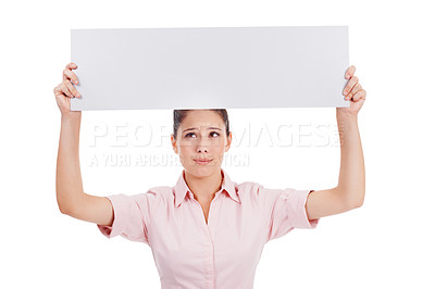 Buy stock photo Shot of a young women holding a blank banner over her head isolated on white