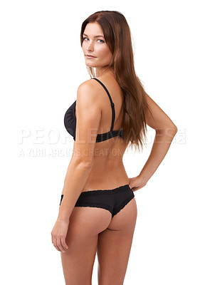 Buy stock photo Rearview shot of an attractive young woman posing in lingerie against white background