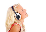 Profile view of a young female listening to music over white
