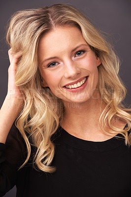 Buy stock photo Portrait of a beautiful young blonde woman smiling sweetly in studio