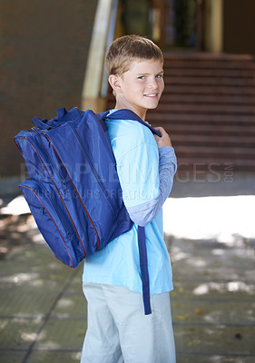 Buy stock photo A smiling young boy wearing a backpack on his way to school - portrait