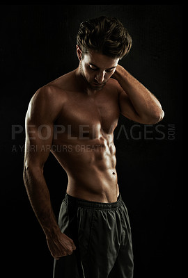 Buy stock photo Gorgeous man with a sculpted body isolated on black