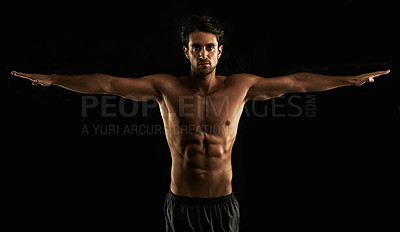 Buy stock photo Handsome topless man raising his arms to his side - Isolated on black
