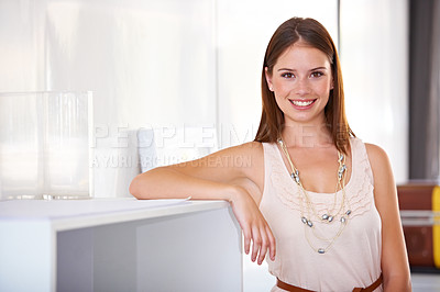 Buy stock photo A gorgeous young designer leaning against a mantle
