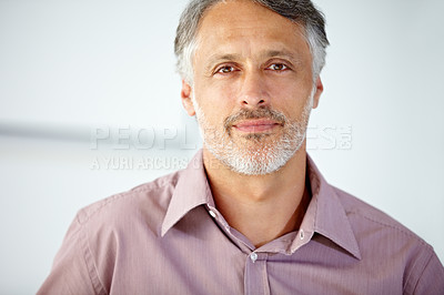 Buy stock photo Handsome mature man looking at the camera with composure
