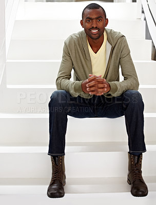 Buy stock photo A handsome ethnic businessman sitting on the staircase alongside copyspace