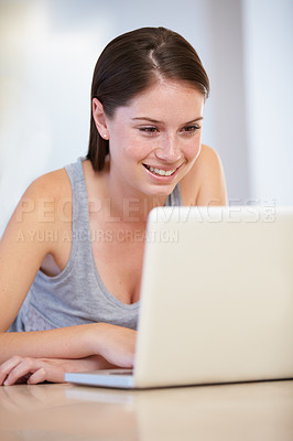 Buy stock photo A gorgeous young woman working on her laptop