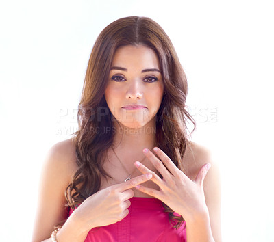Buy stock photo Portrait of an attractive young woman looking sad while gesturing towards her ring finger
