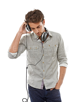 Buy stock photo A handsome young man listening to music