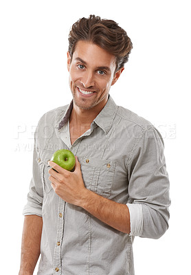 Buy stock photo Portrait of a handsome young man holding an apple and smiing