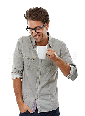 Buy stock photo A handsome young man smiling while holding a cup of coffee