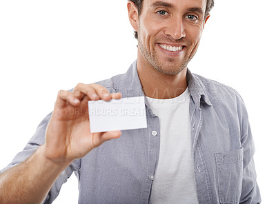 Buy stock photo Portrait of a handsome man holding up a business card of copyspace