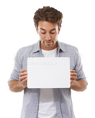 Buy stock photo A handsome young man holding a sign for your copyspace