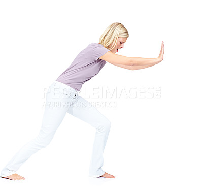 Buy stock photo Pretty young woman pushing a obstacle out of the way