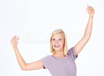 Buy stock photo Cute young woman gesturing a dance while isolated on white