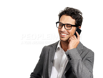Buy stock photo A handsome young businessman talking on his cellphone