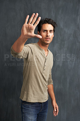 Buy stock photo Portrait of a handsome young man framing you with his hand