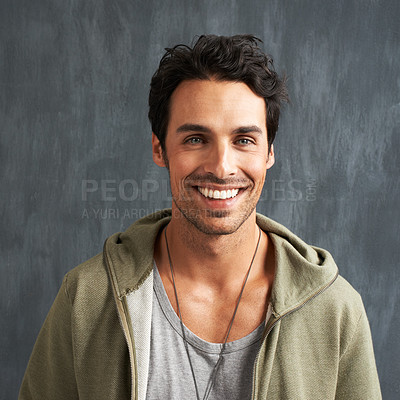 Buy stock photo Portrait of a handsome young man smiling happily