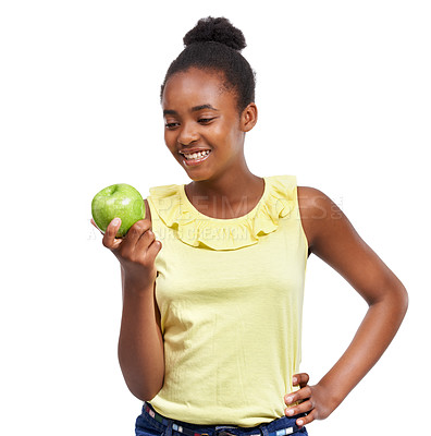 Buy stock photo Shot of a young african american girl holding an apple isolated on white