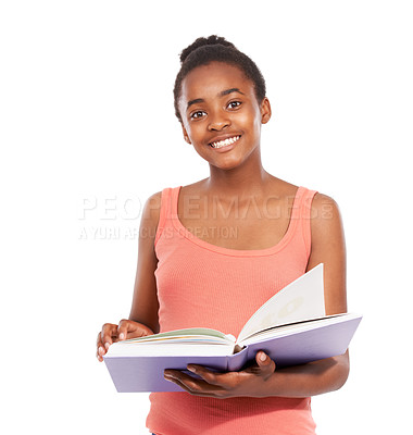 Buy stock photo Studio portrait of a young african american girl reading a book isolated on white