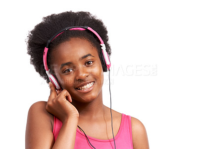 Buy stock photo Studio portrait of a young african american girl listening to music on headphones isolated on white