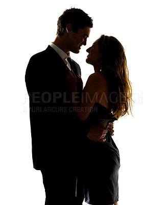 Buy stock photo Portrait of a sweet young couple sharing a special moment against white background