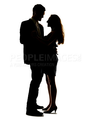 Buy stock photo Portrait of a happy young couple dancing together against white background