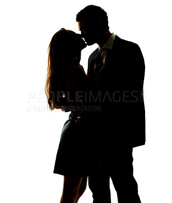 Buy stock photo Portrait of a sweet young couple kissing each other against white background