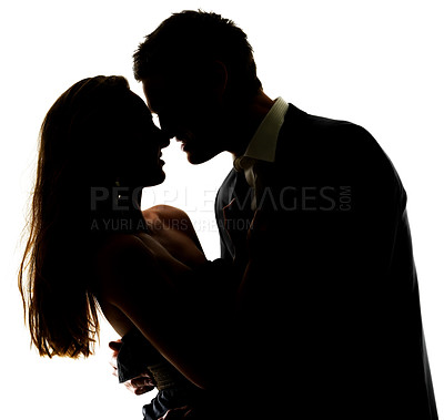 Buy stock photo Portrait of a beautiful young couple about to kiss against white background