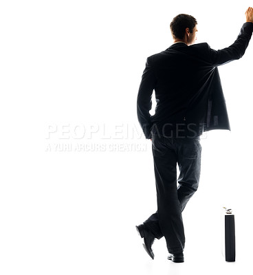 Buy stock photo Rear view of young male business executive standing with his briefcase against white background